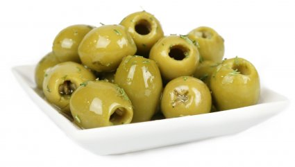image of green olives with basil and garlic